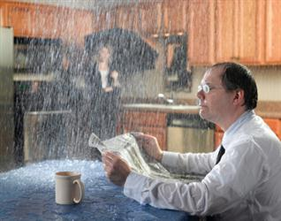 People in need of roof repair in Plumsteadville PA. Leaky roof causing it to rain on people in their kitchen. Humorous.
